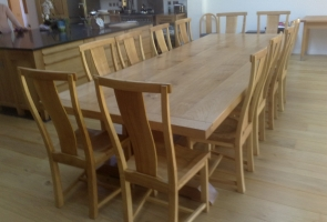 Large twin column table with Curve Back Chairs in our straw finish