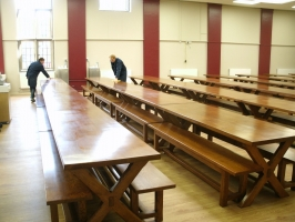 Nine rows of four tables and benches