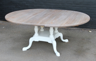 Pullout oval dining table with Farrow and Ball Lime White