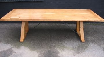 Solid oak dining table with cleated ends in our natural finish