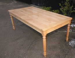 Turned leg dining table in natural wax finish