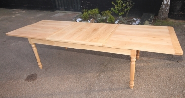 Natural wax finish oak table with extending leaves