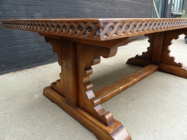 Carved edge oak table with knobbly end base