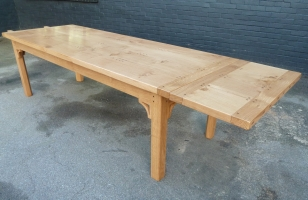 Solid oak Table with extending leaves and square legs with fine carved brackets