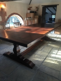 A large square column oak refectory table with an extra think top