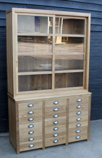 A 2 door sliding glazed cabinet with filing drawers