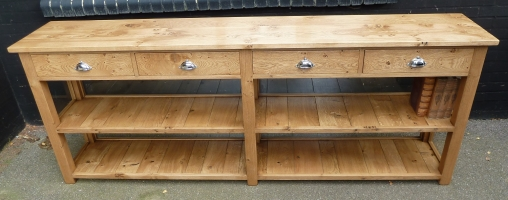Four drawer side board with two pot board shelves
