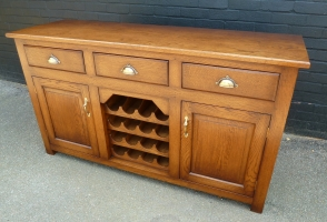 Solid oak three drawer side board with drink rack