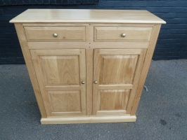Two door cabinet with drawers in our fumed finish