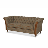 Caesar 2 seater sofa in Gamekeeper spruce with create brown leather hockey sticks
