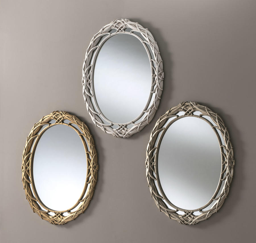 Oval carved wall mirrors